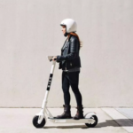 a woman on a bird scooter